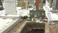 Remains Of Ukrainian Poet In Limbo After Being Exhumed