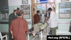 The victims of a roadside bombing in Zabul Province are brought to a hospital on May 10.
