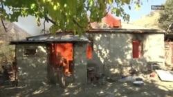 Armenët u vunë zjarrin shtëpive përpara se t'ia dorëzonin fshatin Azerbajxhanit