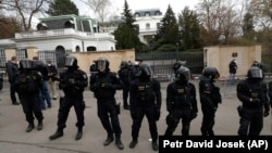 Czech riot police guard the Russian Embassy in Prague on April 18.