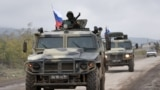 NAGORNO-KARABAKH -- Armored vehicles of Russian peacekeepers move along the road towards Agdam from their check point outside Askeran, November 20, 2020