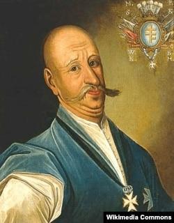 Микола Василь Потоцький (1707/1708–1782) – магнат, меценат, який оплатив перебудову церкви та монастиря у Почаєві, які тоді належали греко-католикам