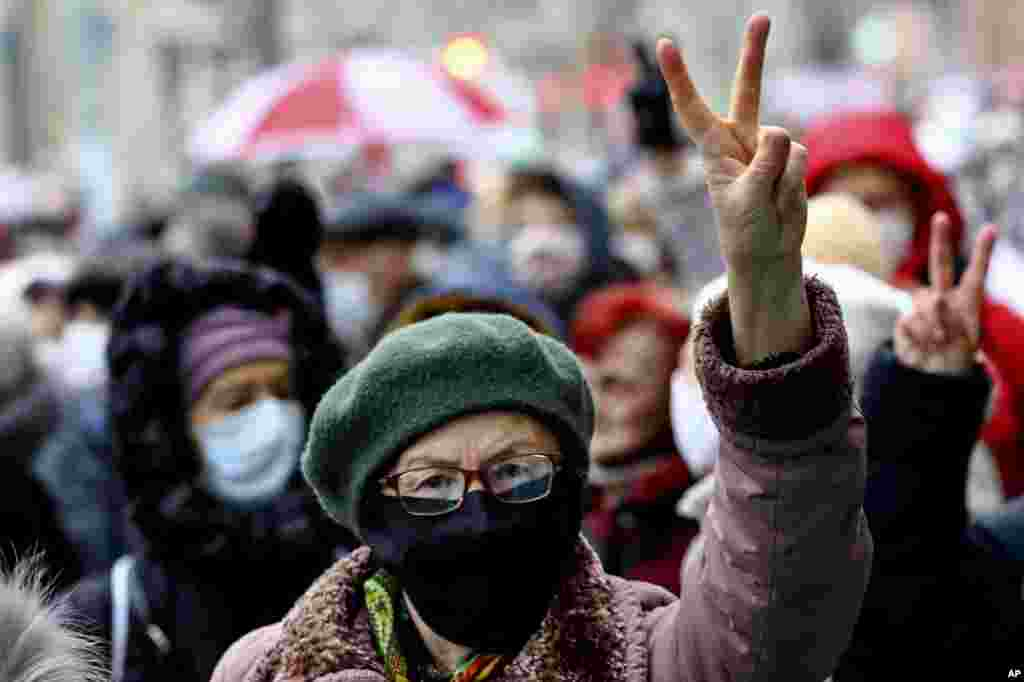 A Belarusian woman gestures as she attends a pensioners' opposition rally in Minsk on November 16. (AP)