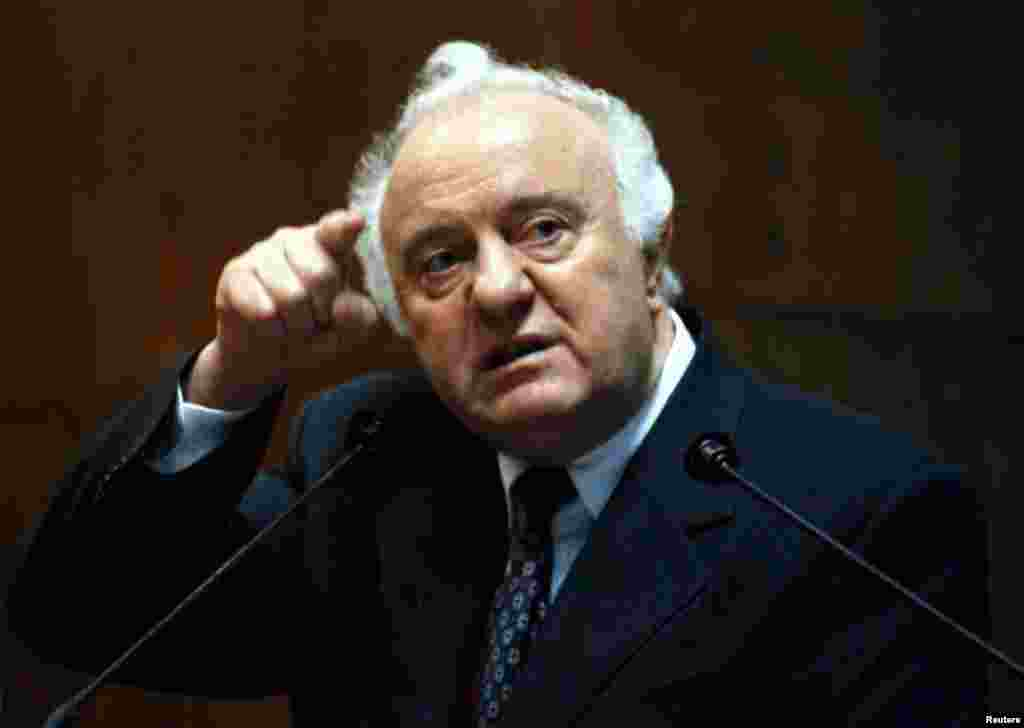 Georgian President Eduard Shevardnadze gestures during a news conference in Tbilisi in 1998.