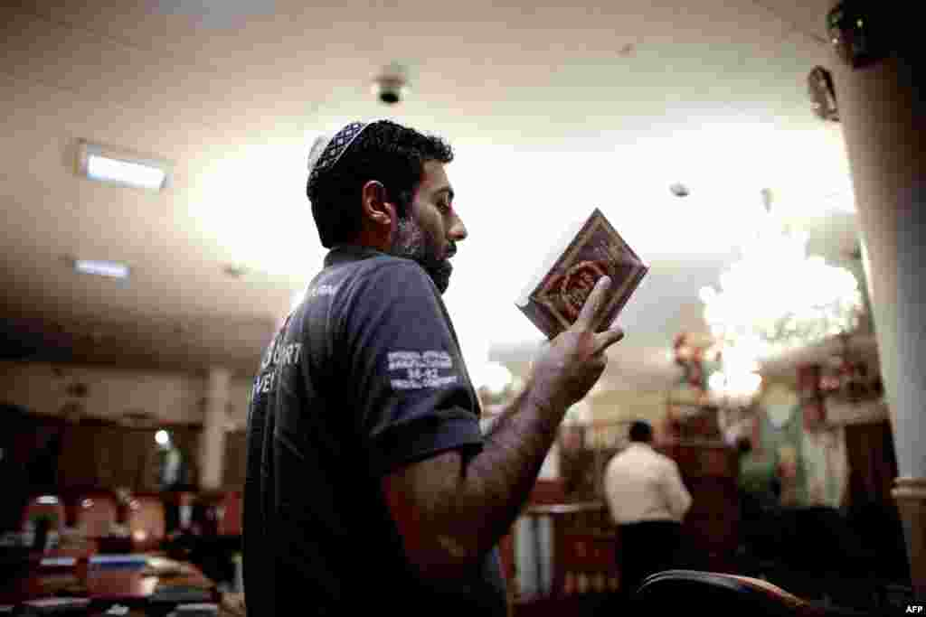 An Iranian Jew reads the Torah at a synagogue in downtown Tehran.