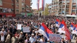 Kosovo -- Ethnic Serbs wave flags during a protest against the accord on the normalisation of relations between Serbia and Kosovo, in the ethnically divided town of Mitrovica, April 22, 2013.