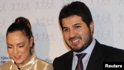 Turkish singer Ebru Gundes (left) stands with her husband, Reza Zarrab, who is in jail awaiting trial on charges of helping Iran evade U.S. sanctions.