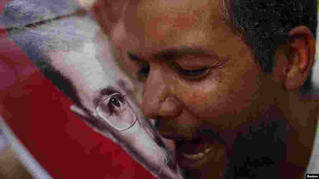 Мохамед Мурсинин жактоочусу. Каир, 23.06.2012
