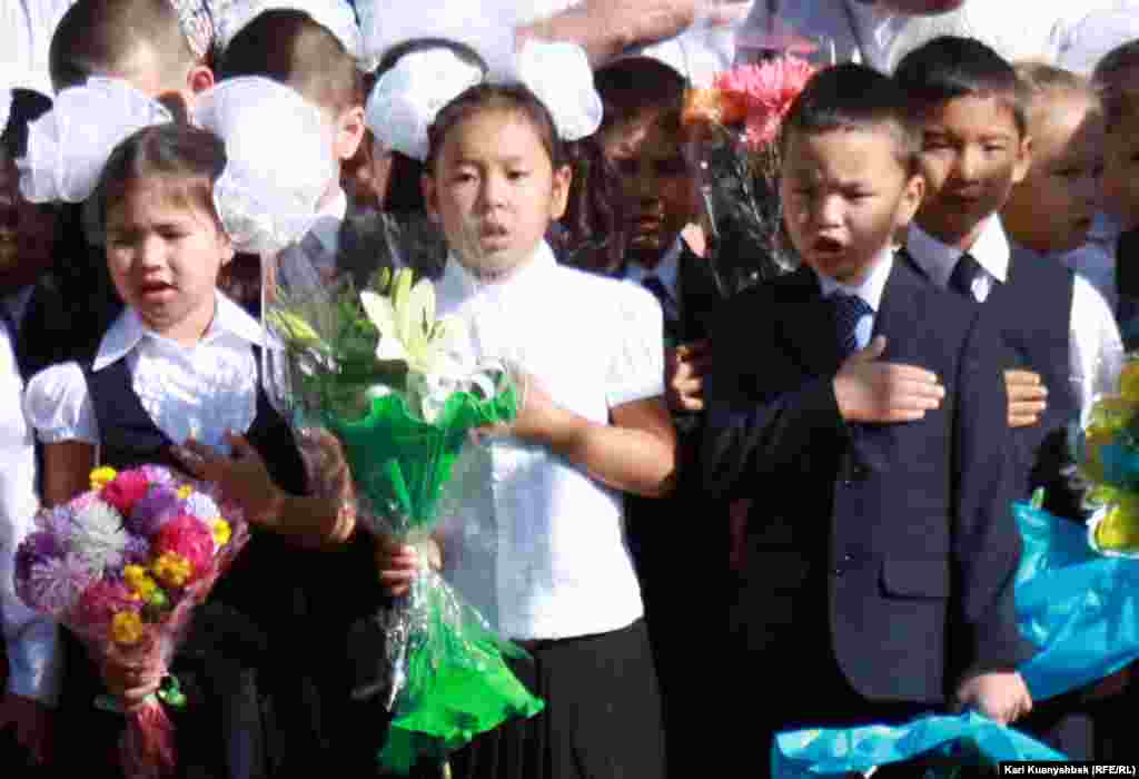 Children at School No. 141 singing the national anthem in Almaty, Kazakhstan.