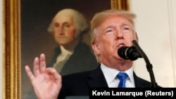 U.S. President Donald Trump speaks about Iran and the Iran nuclear deal in front of a portrait of President George Washington in the Diplomatic Room of the White House in Washington, D.C., October 13, 2017.