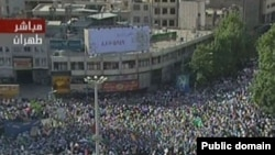 A screen grab from Iranian TV shows thousands of Ahmadinejad supporters rallying in Vali Asr Square in Tehran on June 16.