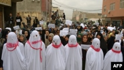 Protesters march during a demonstration, over the killing of seven Shi'ite Hazaras, in Mazar-e Sharif on November 12.