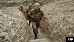 Nagorno-Karabakh -- Armenian soldiers of the self-proclaimed republic of Nagorno-Karabagh walk in a trench at the frontline on the border with Azerbaijan near the town of Martakert, 06Jul2012