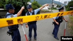 Japan - Police officers investigate near a facility for the disabled, where a deadly attack by a knife-wielding man took place, in Sagamihara, Kanagawa prefecture, Japan, July 26, 2016.