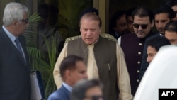 Pakistani Prime Minister Nawaz Sharif (center) leaves with his son Hussain Nawaz (second right) after appearing before an anticorruption commission at the Federal Judicial Academy in Islamabad on June 15.