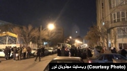 Gonabadi dervishes gathered near the house of their leader to defend it against security forces.
