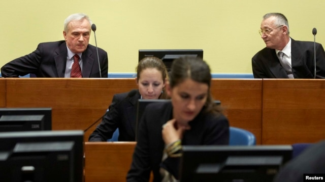 Jovica Stanisic (top left), former chief of Serbian State Security, and Franko Simatovic (top right), former commander of the Special Operations Unit of the Serbian State Security Service, sit in the courtroom in The Hague on May 30, when they were acquitted.