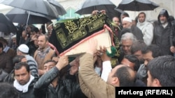 Afghan journalist Sardar Ahmad, his wife, and two children are buried in Kabul on March 23.