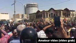 "Crowds shouting ""Death To The Dictator"" as protests spread to several Iranian cities in August."