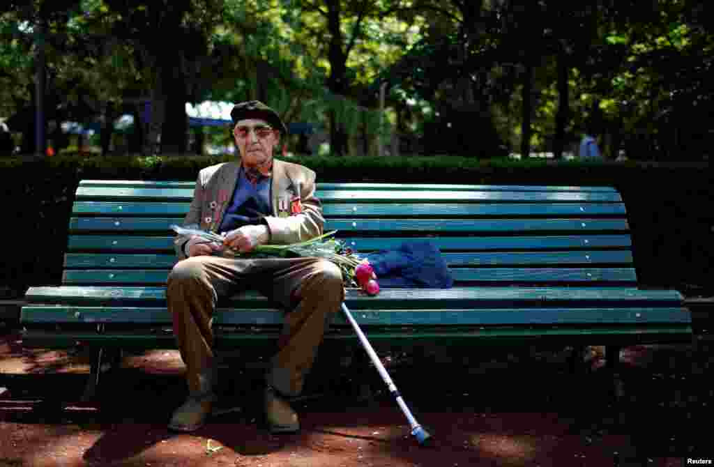 World War II veteran Yury Podgorski, 93, sits on a bench during Victory Day commemorations in Tbilisi, Georgia, on May 9. (Reuters/David Mdzinarishvili)