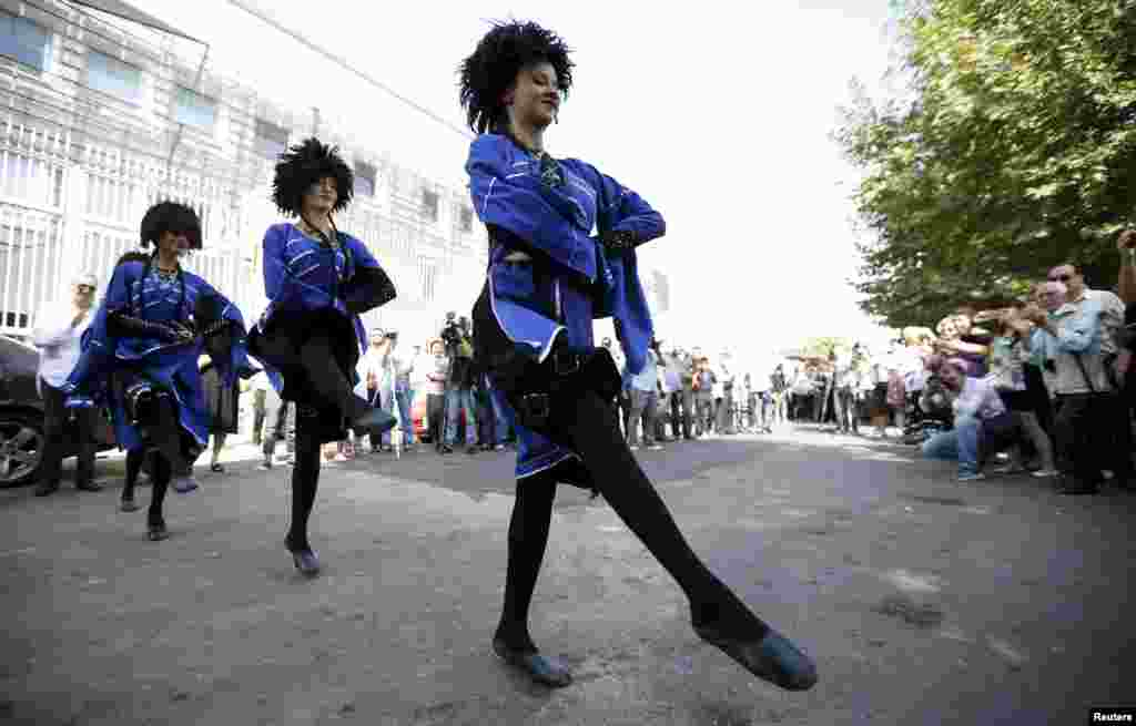 Dancers perform during a rally to demand better relations with Russia in Tbilisi, Georgia. (Reuters/David Mdzinarishvili)
