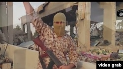 FILE: A screen grab from a video released by the militant group Islamic State (IS) militants threatening Iran.