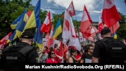 Activists from the two groups had both gathered to rally in front of the presidential office in the Ukrainian capital.