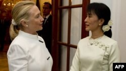 U.S. Secretary of State Hillary Clinton (left) meets with Aung San Suu Kyi in Rangoon on December 1.