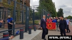 Kosovar President Hashim Thaci (center) leaves the prosecutor's office in The Hague on July 16.