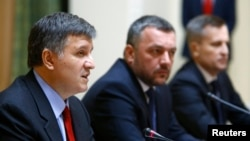 Acting Interior Minister Arsen Avakov speaks alongside acting Prosecutor-General Oleh Makhnytsky, and Ukrainian Security Service (SBU) chief Valentyn Nalyvaychenko (left to right) at a news conference in Kyiv on April 3.