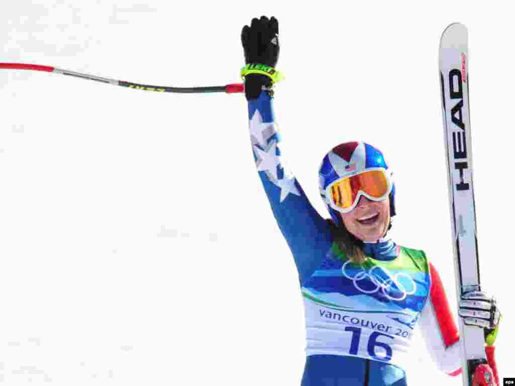 American Lindsey Vonn celebrates after winning a women's downhill gold medal in Vancouver. The cash awards among former Soviet countries compare pretty favorably to those of wealthier Western countries like the United States, which is promising $25,000 for gold, $15,000 for silver, and $10,000 for bronze in Sochi.