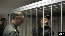 Dmitry Litvinov (right) faced a court in Murmansk on September 26.
