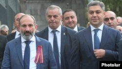Armenia -- Prime Miinister Nikol Pashinian and National Security Service Director Artur Vanetsian (R) walk in downtown Yerevan, September 21, 2018.