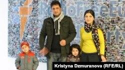 Haseeba Shaheed (r) with her family at RFE/RL's Prague headquarters.