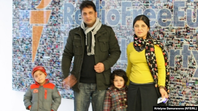 Haseeba Shaheed (r) with her family at RFE/RL's Prague headquarters.