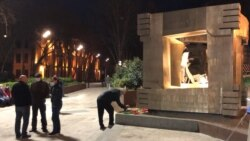 Victims Of Soviet Massacre Honored In Vigil Outside Georgian Parliament