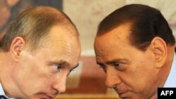 Italian Prime Minister Silvio Berlusconi (right) and his Russian counterpart, Vladimir Putin, confer during Putin's visit to Italy on April 26.
