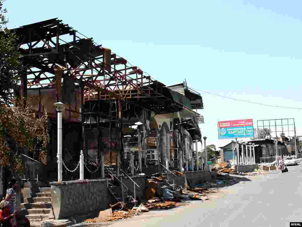 Burned-out stores in Osh city center