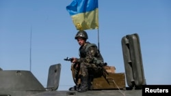 A Ukrainian serviceman stands at a checkpoint near Debaltseve, a city in the Donetsk Oblast.