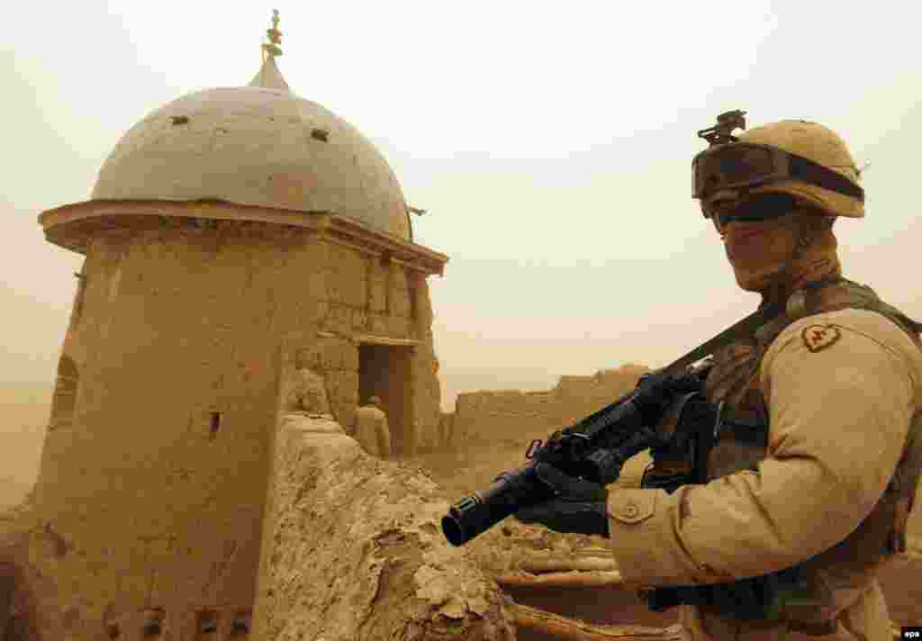 A U.S. soldier patrols the 19th-century Khir-Kot fort in Paktika Province in October 2004 (epa) - When the U.S.-led international coalition force overthrew the Taliban, it secured the major cities, but elsewhere focused on hunting the remnants of the Taliban and Al-Qaeda, rather than on establishing order and maintaining day-to-day security. In 2006, insurgents stepped up activities in the south and southeast, prompting NATO to increase its presence in four southern provinces substantially.