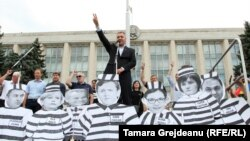 "The protesters chanted slogans such as ""Down with the mafia,"" and held posters showing pictures of the judges under the words ""List of shame."""