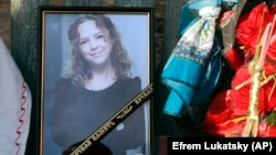 Iryna Nozdrovska is seen in a photograph that was placed near her coffin in her hometown of Demydiv on January 9.