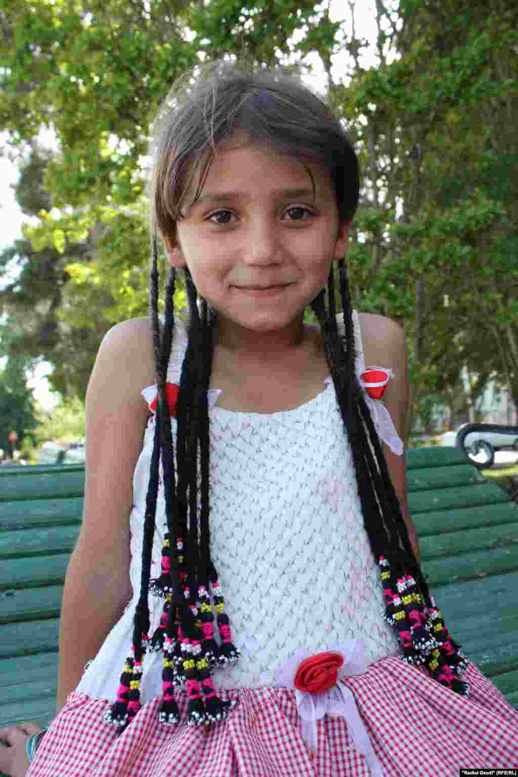 Jasmina, 6, sells chewing gum and chocolate on the streets of Dushanbe, the capital of Tajikistan. Her father is a migrant worker in Russia. She wishes for him to come home as soon as possible, and dreams of becoming a doctor.