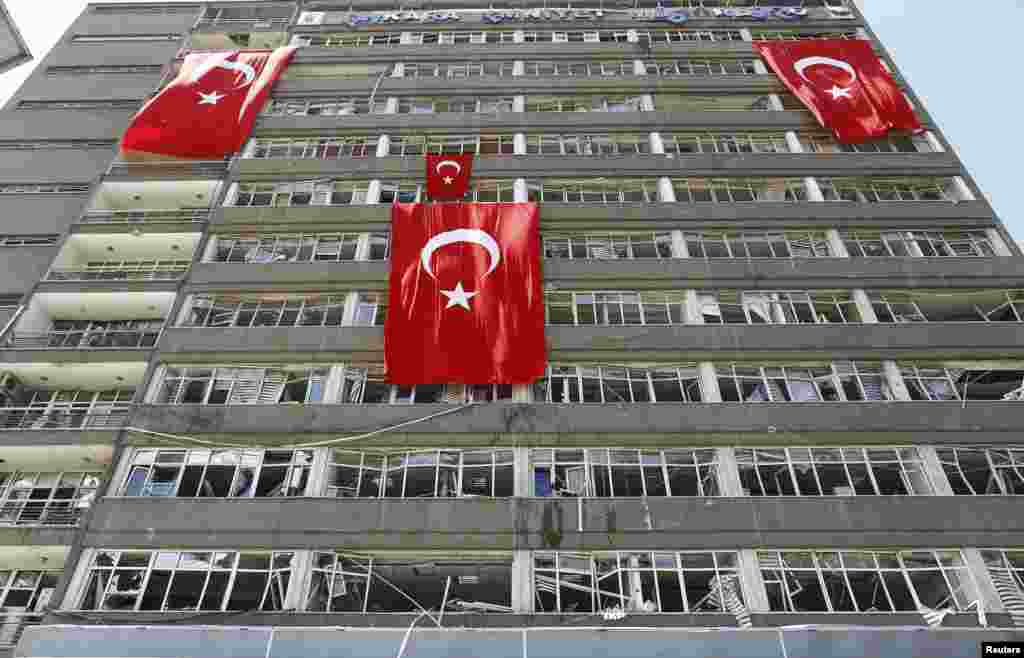 Turkish flags hang on the facade of the damaged building of police headquarters in Ankara, Turkey, following the failed coup attempt last weekend. (Reuters/Osman Orsal)
