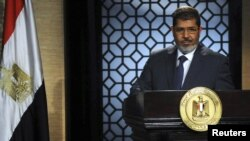 Egypt -- Muslim Brotherhood's president-elect Muhammad Morsi speaks during his first televised address to the nation at the Egyptian Television headquarters in Cairo, 24Jun2012