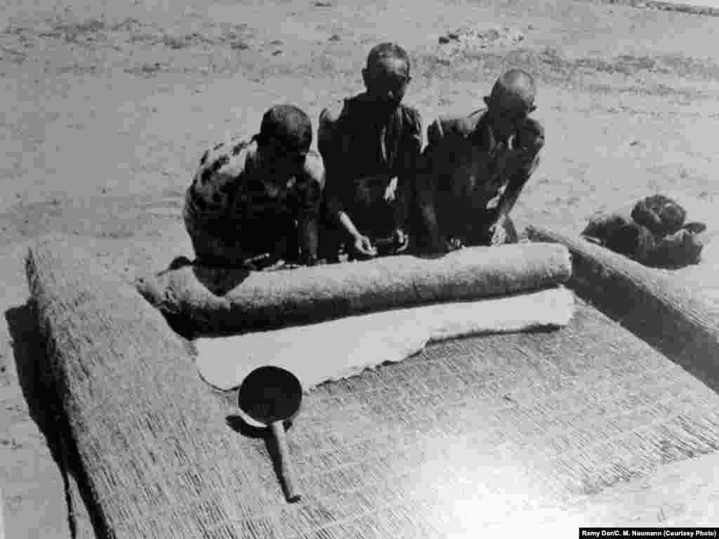 An archival photo of men pressing felt, one of the items traded by the Pamir Kyrgyz.