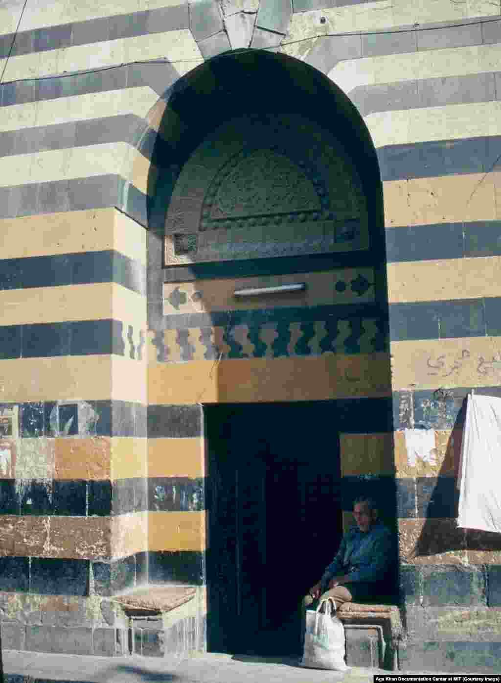 The entrance to a bathhouse in Aleppo in 1991. A degree of stability returned to Syria under Hafez al-Assad, but the tactics of his security services were ruthless.