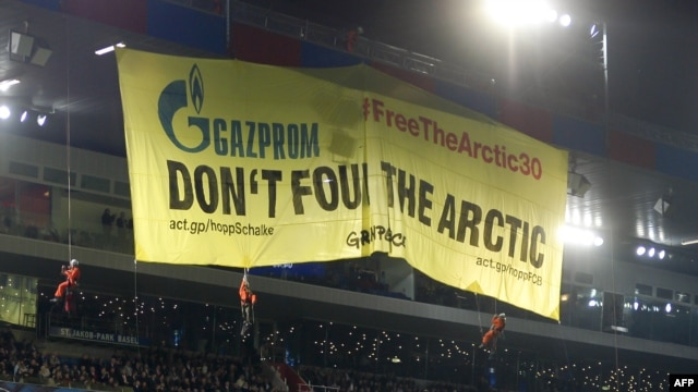 Greenpeace activists deploy a banner to protest against Russia's Gazprom during the Champions League soccer match in Basel on October 1. Gazprom is a sponsor of the competition, as well as German club FC Schalke, which was playing FC Basel.