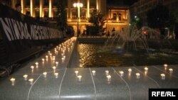 Members of the Youth Initiative for Human Rights lit candles in Andric's park in downtown Belgrade to pay tribute to the victims of genocide in Srebrenica