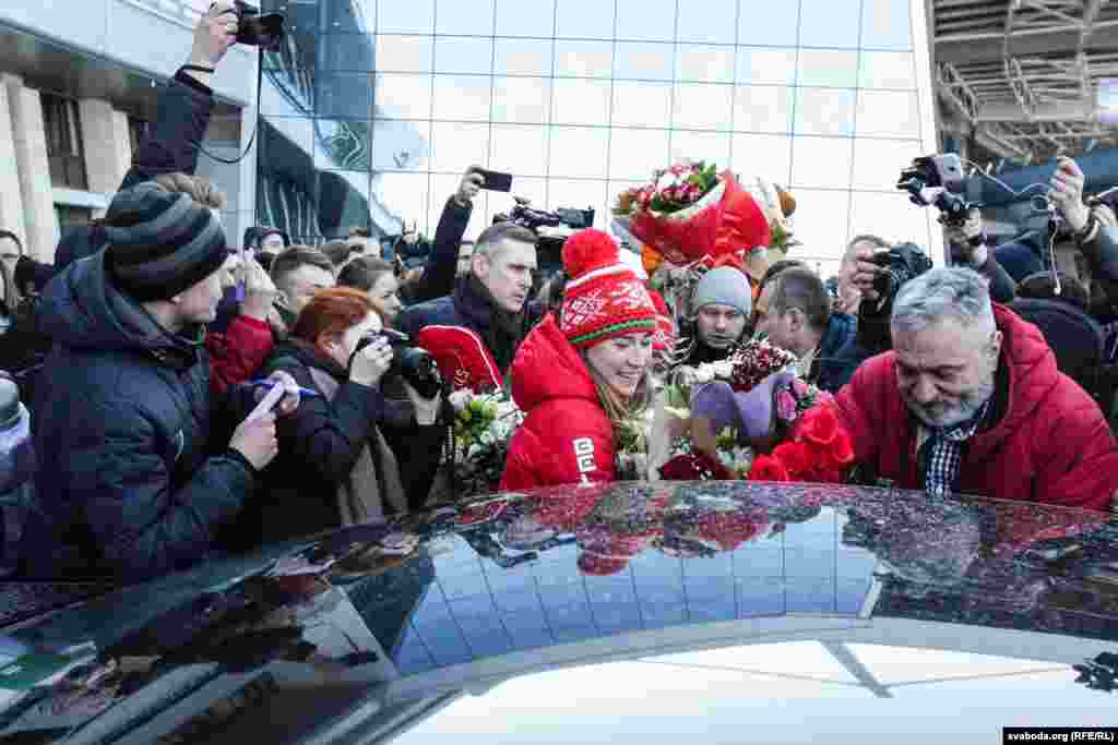Dzinara Alimbekava, a gold medalist in the women's relay biathlon at the 2018 Winter Olympics, returns home to Belarus from Pyeongchang on February 27. The national team of Belarus won two gold medals and one silver. (RFE/RL)